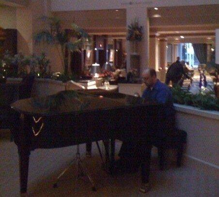 The Conductor plays piano at The Cincinnatian