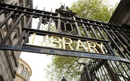 library gold letters on a grating black metal door