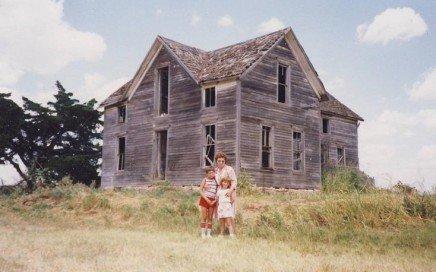 Benjamin Vogt standing in front of the homestead (1980s)