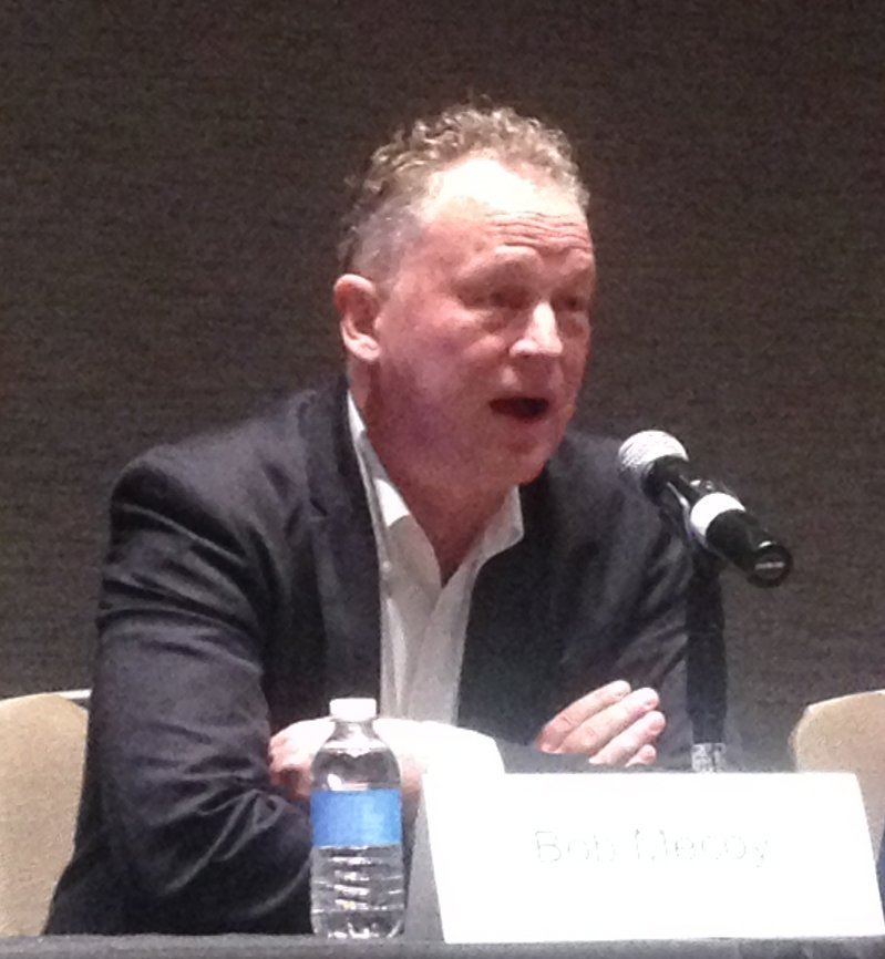 Agent Bob Mecoy speaking at a conference panel